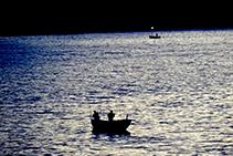 Pescadores al anochecer.