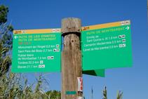 Cartel indicativo de la ruta de las Ermites.